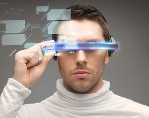 Man looks through data glasses